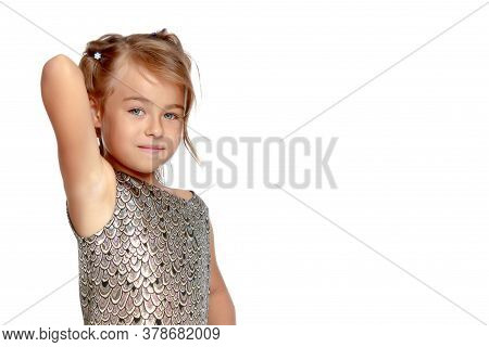 Fashionable Little Girl In A Dress. Beauty And Style In Childrens Clothes. Isolated Over White Backg