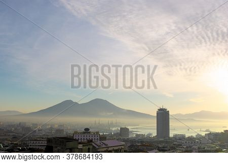 mist at sunrise on landscape of Naples bay and volcano Vesuvius, two landmarks of Campania tourism