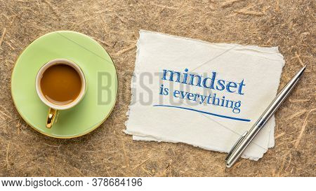 mindset is everything - inspirational handwritten note on handmade paper with a cup of coffee, business, education and personal development concept