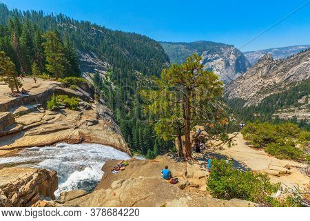 Yosemite, California, United States - July 24, 2019: People Resting On Top Of Nevada Fall Waterfall