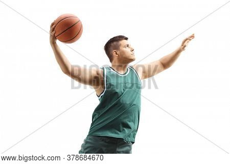 Male basketball player in action with a ball performing slam dunk isolated on white background