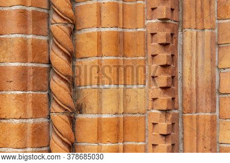 Brick Work Wall With Ornament On Old Building. Red Brick Wall Texture Architecture Background. Patte