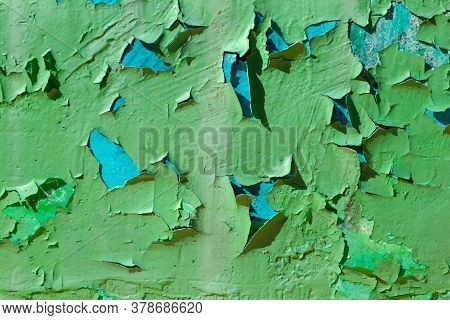The Photo Of Cracked And Peeling Paint On The Old Wall. Grunge Texture - Abstract Background. Scratc