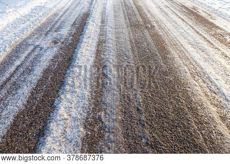 Winter Time On A Narrow Rural Highway, The Road Is Covered With Snow After Snowfall, Frosty Weather