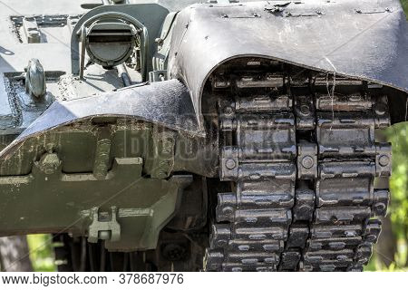 Close-up Of The Chassis Of An Old Tank, Metal Massive Heavy Construction Of Military Equipment