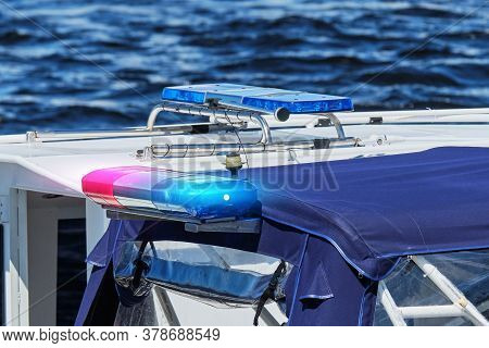 Police Combat Boat On Water With Special Lights On.