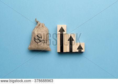 The Concept Of A Gradual Increase In Capital And Money. Money Bag And Up Arrow Image.