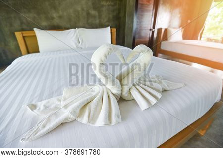 White Clean Bath Towel On Bed Decoration Interior Of Bedroom / White Towel On Bed In Guest Room For