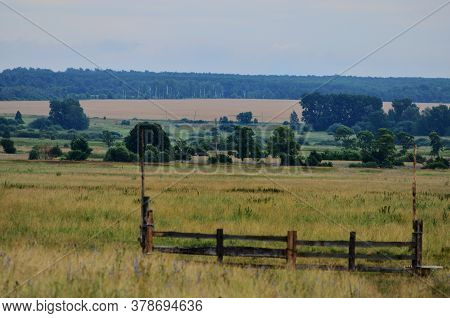 Pasture For Cattle In The Foreground Gate From The Electric Shepherd Landscape Of The Countryside, R