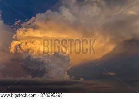Sunset Sky Background. Picturesque Colorful Golden Sky Clouds Lit By Evening Soft Sunlight. Vast Sky