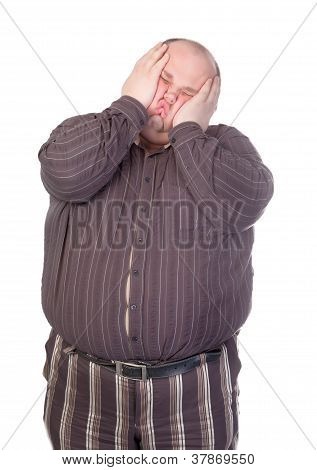Obese man standing squashing his face with his hands with his buttons popping open over his huge belly isolated on white poster