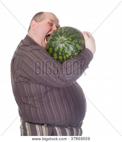 Obese Man Biting A Watermelon