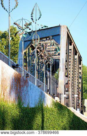 July 27, 2020 In Whittier, Ca:  Vintage Railroad Trestle On Former Railroad Tracks Besides Wind Scul