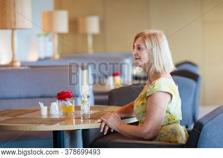 Senior Woman In Cafe. Lady In Restaurant.