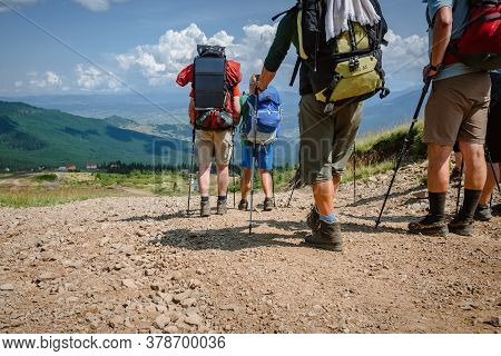 Ivano-frankovsk, Ukraine- July 27, 2019: Group Of Tourists Having Journey And Hiking In Carpathians