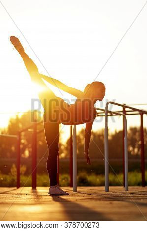Stretching Fit Or Dancer Woman Doing Vertical Split, Twine In Workout Sports Ground. Dancer Silhouet