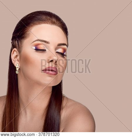 Portrait Of Attractive Young Woman With Beautiful Hairstyle And Make-up Posing On Salmon Shade Red B