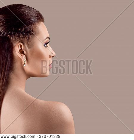 Fashion Portrait Of Pretty Stylish Woman Posing Topless On Salmon Red Background