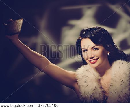 Pretty Happy Woman With Stylish Hairstyle And Fur Coat Photographing. Retro Style Toned Image