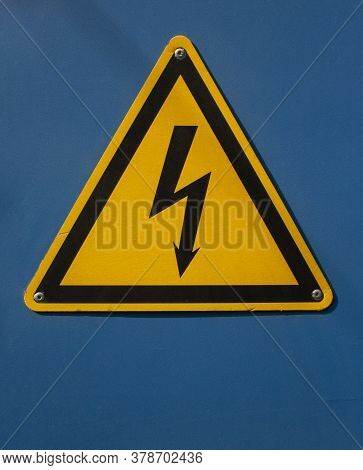 High Voltage Sign With Lightning On A Blue Background. Danger High Voltage. High Voltage Style Moder