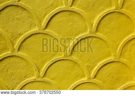 Abstract Yellow Fluted Ornament On The Yellow Wall Of The House. Pattern Of Yellow On Wall. Seamless