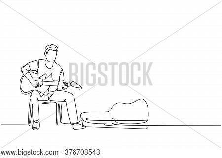 One Continuous Line Drawing Of Young Happy Male Guitarist Sitting And Busking By Playing Guitar On U