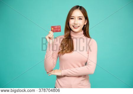 Asian Woman Smiling, Showing, Presenting Credit Card For Making Payment Or Paying Online Business, P