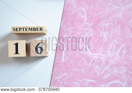 September 16, Empty White - Pink Background With Number Cube.