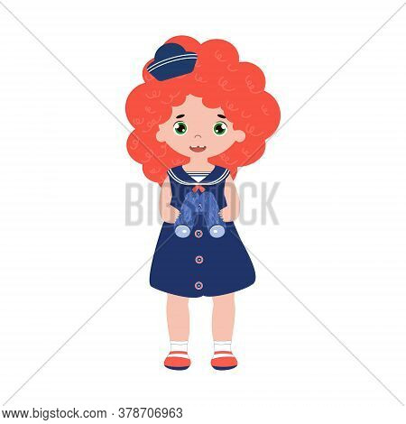 An Adorable Little Girl In A Sailor Suit And A Cap Of 1950s Fashion. A Kid Dreams Of Being A Captain