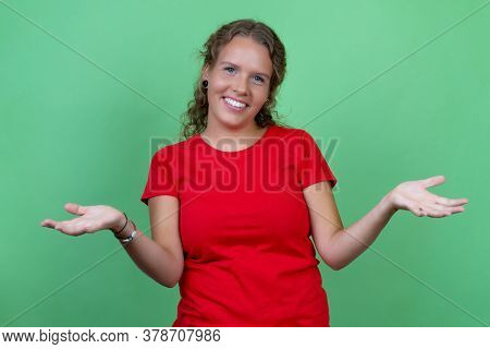 Beautiful Blond Woman With Red Shirt Isolated On Green Background