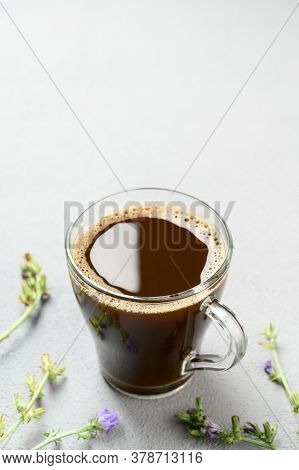 Alternative To Coffee. Healthy Drink Chicory. Chicory Coffee In A Glass Cup On A Light Gray Table. S
