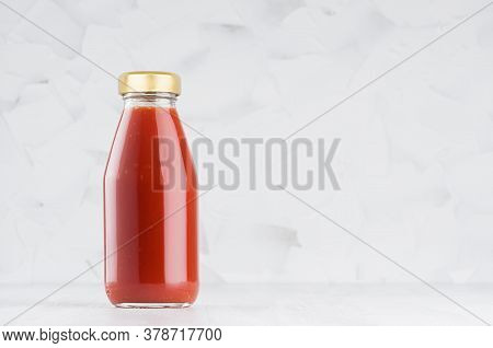Red Tomato Juice In Glass Bottle With Gold Cap Mock Up On White Wood Table In Light Interior With Co