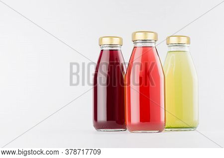 Red, Pink, Green Fruit Juices Collection In Glass Bottles With Cap Mock Up On White Background, Temp
