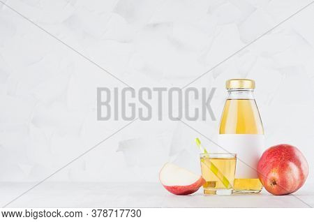 Summer Yellow Pear  Juice In Glass Bottle Mock Up With Blank Label, Straw, Wine Glass, Fruit Slice O