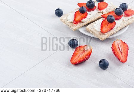 Summer Light Sweet Vegetarian Open Sandwiches On Crisps Bread With Ripe Strawberry Slices, Blueberry