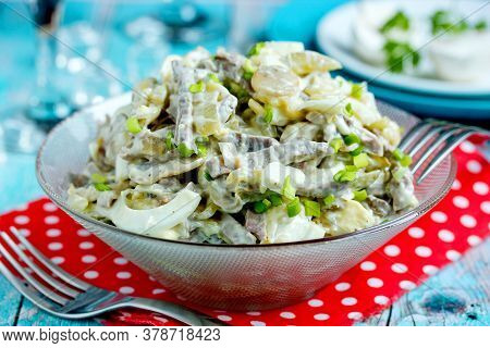 Fried Mushroom, Meat, Onion And Egg Salad In A Glass Bowl