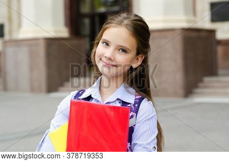 Back To School. Education Concept. Cute Smiling Schoolgirl Preteen On The Way To The School. Happy L
