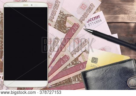 100 Russian Rubles Bills And Smartphone With Purse And Credit Card. E-payments Or E-commerce Concept