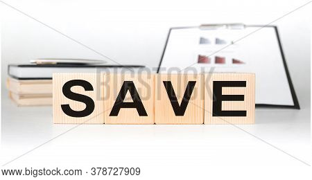 Word Save On Wooden Cubes On A White Background With A Business Theme. Money Saving And Taxes Saving