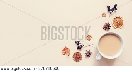 Autumn Pastel Background. A Cup Of Hot Coffee Or Tea With Milk With Autumn Leaves And Anise. Banner