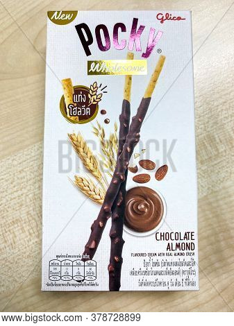 Bangkok Thailand - 30 July 2020: Glico Pocky Wholesome Biscuit Sticks Box New Flavour On The Wood Ta
