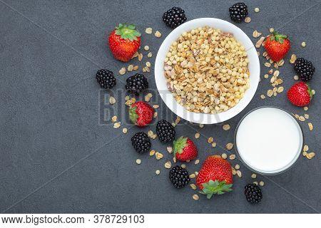 Healthy Breakfast Ingredients. Homemade Granola In White Plate, Milk Or Yogurt In Glass, Blackberrie