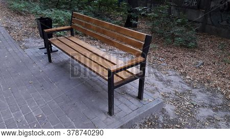 A Bench Made Of Wood And Metal Stands The Park