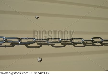 Light Metal Chain On A Different Background