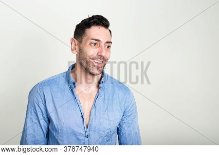 Portrait Of Happy Handsome Businessman With Beard Stubble