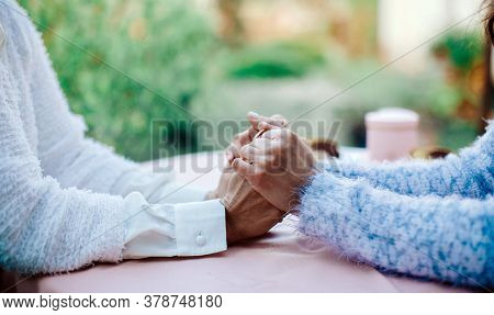 People, Age, Family, Care And Support Concept - Close Up Of Senior Woman And Young Woman Holding Han