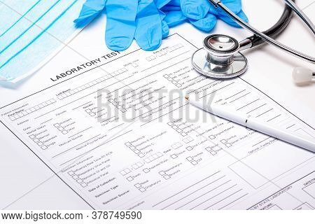 Laboratory Form To Fill Of Blood Test, Mask, Gloves, Stetoscope And A Pen