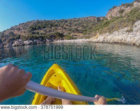 Colorful Yellow Kayak At Blue Sea  Water During Summer Vacation