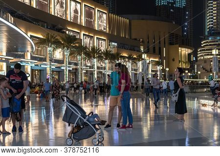 Dubai, Uae - April 8. 2018. Tourists On Square At Fountain In Front Of Dubai Mall.