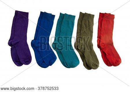 Top View Of New Colorful Socks Isolate On White Background.